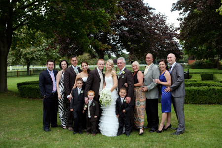 bride and groom with families
