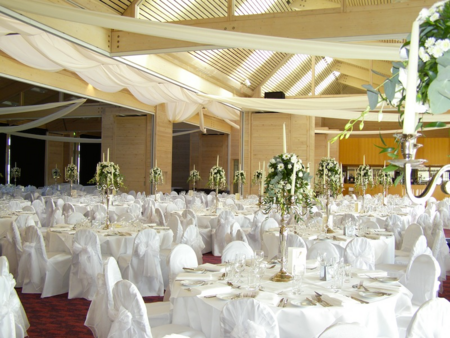 all white tables and decorations at wedding