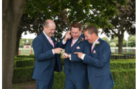 Grooms-men Admiring Grooms Wedding Ring