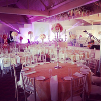 Wedding Reception with Large Table Pieces made of Candelabras